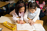 Education Elementary School Grade 2 two girls working together on social studies project drawing map