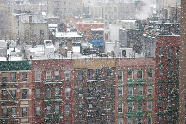 AVAILABLE FOR LICENSING FROM PLAINPICTURE.  Please go to www.plainpicture.com and search for image # p5690226.<br /> <br /> Tenement Apartment Buildings in Lower Manhattan Viewed from above on a Snowy Winter Day, Monroe Street, Lower East Side/Chinatown, New York City, New York State, USA