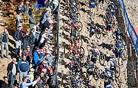 running out of the infamous Zonhoven 'Pit' with a former Paris-Roubaix winner amongst the spectators...<br /> <br /> Elite Men's Race<br /> 2021 UCI cyclo-cross World Cup - Zonhoven (BEL)<br /> <br /> ©kramon