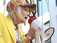 Dame Vivienne Westwood takes part in a photocall which sees her suspended 10ft high inside a giant bird cage outside The Old Bailey in protest against the extradition of Julian Assange, Old Bailey, London on July 21st 2020<br /> <br /> Photo by Keith Mayhew