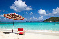 Red chair and striped umbrella<br /> Hawksnest Beach<br /> Virgin Islands National Park <br /> St. John, U.S. Virgin Islands