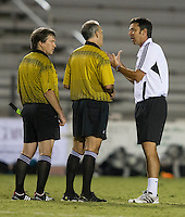Number 8 ranked Charlotte beats number 16 ranked Coastal Carolina 1-0 on a goal by Thomas Allen in the 101st minute during the second overtime.  Coastal Carolina coach Sean Dockings questions the referees after the injury to Pedro Ribeiro (10).