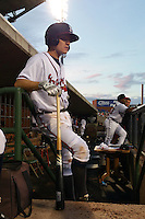 Mississippi Braves second baseman Corban Joseph (2) in the dugout during a game against the Pensacola Blue Wahoos on May 27, 2015 at Trustmark Park in Pearl, Mississippi.  Pensacola defeated Mississippi 7-5 in fourteen innings.  (Mike Janes/Four Seam Images)
