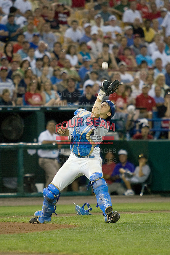 UCLA catcher Steve Rodriguez catches a pop up in Game One of the NCAA Division One Men's College World Series Finals on June 28th, 2010 at Johnny Rosenblatt Stadium in Omaha, Nebraska.  (Photo by Andrew Woolley / Four Seam Images)