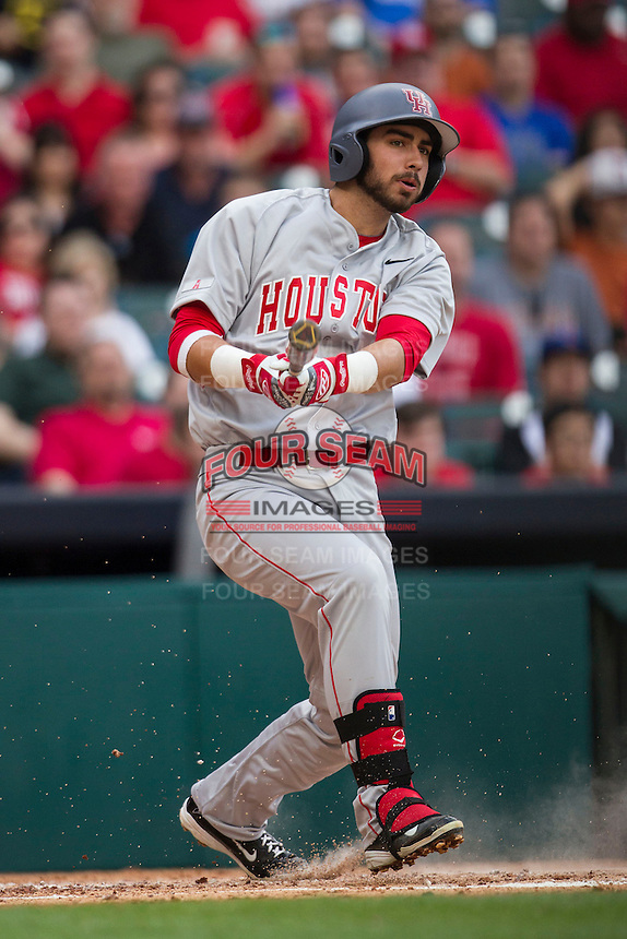 Houston Cougars third baseman Justin Montemayor #20 follows through on his swing during the NCAA baseball game against the Texas Longhorns on March 1, 2014 during the Houston College Classic at Minute Maid Park in Houston, Texas. The Longhorns defeated the Cougars 3-2. (Andrew Woolley/Four Seam Images)