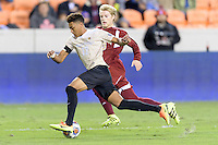 Houston, TX - Friday December 9, 2016: Logan Gdula (17) of the Wake Forest Demon Deacons races for the goal with Alex Underwood (23) of the Denver Pioneers in pursuit at the NCAA Men's Soccer Semifinals at BBVA Compass Stadium in Houston Texas.