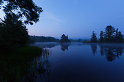 Coffin Pond in Sugar Hill, New Hampshire at morning blue hour during the summer months.