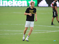 WASHINGTON, DC - AUGUST 25: Henry Kessler #4 of New England Revolution warming up during a game between New England Revolution and D.C. United at Audi Field on August 25, 2020 in Washington, DC.