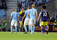 Thursday 08 August 2013<br /> Pictured: Referee Serdar Gozubuyuk (in black) has a word with Michu of Swansea (2nd L) seconds before he was shown a yellow card.<br /> Re: Malmo FF v Swansea City FC, UEFA Europa League 3rd Qualifying Round, Second Leg, at the Swedbank Stadium, Malmo, Sweden.