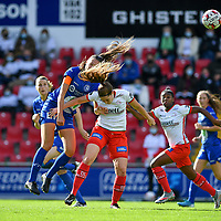 Gent's Silke Vanwynsberghe (21) pictured in a ( hair ) air duel with Essevee's Anne-Lore Scherrens during a female soccer game between Zulte Waregem and the KAA Gent Ladies on the fourth matchday of the 2020 - 2021 season of Belgian Scooore Womens Super League , saturday 10 October 2020  in Waregem , Belgium . PHOTO SPORTPIX.BE | SPP | DAVID CATRY
