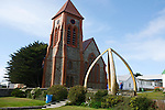 Christ Church cathedral in Stanley. In front, the Whalebone arch (made with 2 jawbones of blue whales coming from South georgia whaling stations) commemorate the centenary of British rule in the Faklands.