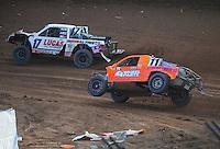 Dec. 11, 2011; Chandler, AZ, USA;  LOORRS pro 2 driver Carl Renezeder (17) and Adrian Cenni (11) during the Lucas Oil Challenge Cup at Firebird International Raceway. Mandatory Credit: Mark J. Rebilas-
