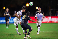LAKE BUENA VISTA, FL - JULY 20: Joao Moutinho #4 of Orlando City SC heads the ball during a game between Orlando City SC and Philadelphia Union at Wide World of Sports on July 20, 2020 in Lake Buena Vista, Florida.