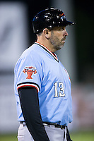 Hickory Crawdads manager Steve Mintz (13) coaches third base during the game against the Kannapolis Intimidators at Kannapolis Intimidators Stadium on April 9, 2016 in Kannapolis, North Carolina.  The Crawdads defeated the Intimidators 6-1 in 10 innings.  (Brian Westerholt/Four Seam Images)