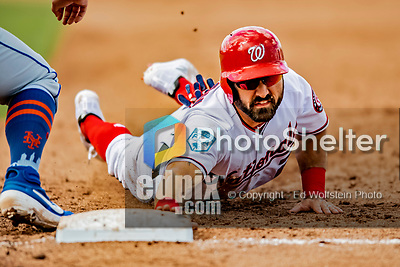 7 March 2019: Washington Nationals outfielder Adam Eaton dives safely back to first on a p[ick-off attempt in the 5th inning of a Spring Training Game against the New York Mets at the Ballpark of the Palm Beaches in West Palm Beach, Florida. The Nationals defeated the visiting Mets 6-4 in Grapefruit League, pre-season play. Mandatory Credit: Ed Wolfstein Photo *** RAW (NEF) Image File Available ***