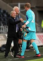 (L-R) Brian Flynn congratulates Gerhard Tremmel during the Alan Tate Testimonial Match, Swansea City Legends v Manchester United Legends at the Liberty Stadium, Swansea, Wales, UK