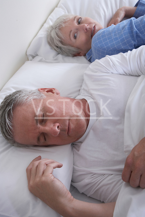 High angle view of mature couple in bed