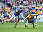 Podge Collins of Clare in action against Seamus Kennedy of Tipperary during their quarter final at Pairc Ui Chaoimh. Photograph by John Kelly.