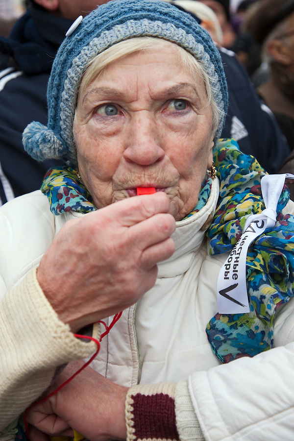 Moscow, Russia, 24/12/2011..A woman blows a whistle as an estimated crowd of up to 100,000 protested against election fraud and Prime Minister Vladimir Putin in the largest anti-government demonstration in Russia since the collapse of the Soviet Union.