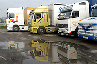 - trucks parked near Esso oils warehouse of Trecate (Novara)....- autocarri in sosta presso il deposito Esso petroli di Trecate (Novara)