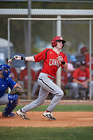 Canada Junior National Team Mason Dobie (18) bats during an exhibition game against the Toronto Blue Jays on March 8, 2020 at Baseball City in St. Petersburg, Florida.  (Mike Janes/Four Seam Images)