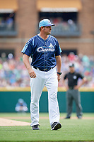 Columbus Clippers pitching coach Steve Karsay (35) walks back to the dugout after a mound visit during a game against the Gwinnett Stripers on May 17, 2018 at Huntington Park in Columbus, Ohio.  Gwinnett defeated Columbus 6-0.  (Mike Janes/Four Seam Images)