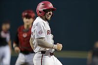 Arkansas catcher Casey Opitz (12) reacts as he runs home for a score, Monday, June 7, 2021 in the eighth inning of the NCAA Fayetteville Regional at Baum-Walker Stadium in Fayetteville. Check out nwaonline.com/210608Daily/ for today's photo gallery. <br /> (NWA Democrat-Gazette/Charlie Kaijo)