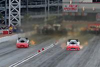 Apr. 2, 2011; Las Vegas, NV, USA: NHRA funny car driver Gary Densham (left) races alongside Johnny Gray during qualifying for the Summitracing.com Nationals at The Strip in Las Vegas. Mandatory Credit: Mark J. Rebilas-