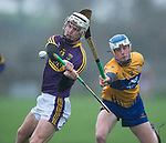 Cathal Dunbar of Wexford in action against Diarmuid Ryan of Clare during the Jack Lynch Memorial game at Tulla. Photograph by John Kelly.