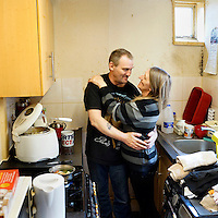 Kevin (52) and Angela Turner (51).<br /> <br /> We were putting all our money on the electricity and gas…. If there was food in the house I made sure the other three was eating and starve myself, which according to my consultant [doctor] was not a good move. I was having to put more money on that, than what's in my sons belly…. For you to take your tablets you've got to eat- If you don't eat you'll have a ruptured hernia or something even worse you could bleed…. I spoke to the school and they said go to the foodbank.  And for two months I wouldn't go. I won't go cap in hand, I'm already sponging off society, in my eyes.  And she said Not with what you''ve got - you banged your head, you've got to take your handouts'…. We only went the once [to the foodbank], about a month ago. It put pressure on us, the wife and I were arguing.  My eldest went to army careers office and said I'm 13 and I want to join the army. -- Why do you want to go in the army? -- He said Well I want to give back to this country what its given me.  …. At one stage I told my eldest son, he was watching a bit of telly with me and I said You know what? When you've gone to bed you'll find me dead in this chair'. He said Why?. I said See all those tablets up there? I am taking the flaming lot. Of course he wouldn't go to bed till dad went to bed. You're going to sleep on it and tomorrow morning, everything will be fine.… Just after using the food bank I felt suicidal, I thought for a guy to be embarrassed like that…. I felt more lower after using it than before, it was like - I have let the family down…. I know what it's like to starve. I know what it's like to starve for three days. Every week. Sometimes it was five days. Even now, I have just a sandwich…. I've had epilepsy since 1985 when I had a push bike accident and wasn't wearing a helmet. It got really bad so I had to go unemployed. I used to be a chef back in the 1990s at Butlins [holiday resort]. I like cooking, I get a passio