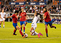 HOUSTON, TX - FEBRUARY 03: Carli Lloyd #10 of the USA attacks with the ball and is defended by Fabiola Sanchez #5 and Lixy Rodriguez #12 of Costa Rica during a game between Costa Rica and USWNT at BBVA Stadium on February 03, 2020 in Houston, Texas.