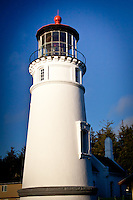The Umpqua River Lighthouse from the southwest.  The lighthouse stands at the mouth of the Umpqua River where it empties into Winchester Bay on the Oregon Coast.