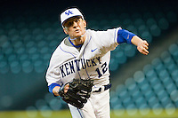Relief pitcher Corey Littrell #12 of the Kentucky Wildcats delivers a pitch to the plate against the Houston Cougars at Minute Maid Park on March 5, 2011 in Houston, Texas.  Photo by Brian Westerholt / Four Seam Images