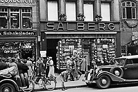 Vandalized Souvenir shop Adolf Salberg, Koenigstr 36, Nuremberg. Jewish merchant Adolf Salberg owned a chain of shops for souvenirs, postcards, leatherware, watches and clocks, based in Cologne with outlets in Brussels, Antwerp, Munich, Nuremberg, Leipzig, and Wiesbaden.<br /> <br /> On occasion of the Nuremberg Rally in 1935, where the Nuremberg Laws were presented, German propaganda weekly 'Der Stürmer' issued a special edition on September 5th, 1935. The headline reads 'Murderers from the beginning. Jewish world bolshevism from Moses to Comintern'