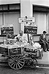 Street vendor selling Fresh Roasted Peanuts and Honeycombe. Clerkenwell, London EC1 UK 1970s