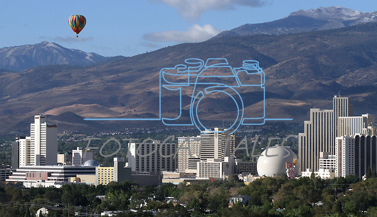 Hot air balloons fly over downtown Reno on media day of the Great Reno Balloon Race on Sept. 9, 2010 in Reno, Nev..Photo by Cathleen Allison