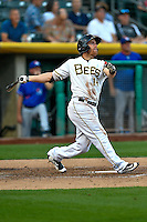 Cal Towey (14) of the Salt Lake Bees hits a home run while at bat against the Round Rock Express in Pacific Coast League action at Smith's Ballpark on August 13, 2016 in Salt Lake City, Utah. Round Rock defeated Salt Lake 7-3.  (Stephen Smith/Four Seam Images)