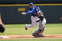 Round Rock Express shortstop Brent Lillibridge #18 turns a double play as New Orleans base runner Jake Marisnick #28 slides into second during the Pacific Coast League baseball game on May 5, 2014 at the Dell Diamond in Round Rock, Texas. The Zephyrs defeated the Express 13-4. (Andrew Woolley/Four Seam Images)