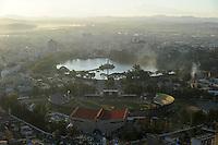 MADAGASCAR city Antananarivo , city view from royal palace complex to Lac Anosy and stadium / MADAGASKAR Hauptstadt Antananarivo, Blick vom koeniglichen Palast auf die Stadt, Stadium und den See Lac Anosy