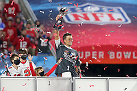 7th February 2021, Tampa Bay, Florida, USA;  Super Bowl MVP Tom Brady (12) of the Buccaneers hoists the Lombardi Trophy after the Super Bowl LV game between the Kansas City Chiefs and the Tampa Bay Buccaneers on February 7, 2021 at Raymond James Stadium