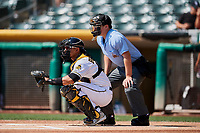 Jose Briceno (14) of the Salt Lake Bees before the game against the Fresno Grizzlies at Smith's Ballpark on September 4, 2017 in Salt Lake City, Utah. Home plate umpire Sean Ryan watches the warm-up pitches. Fresno defeated Salt Lake 9-7. (Stephen Smith/Four Seam Images)