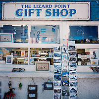 Postcards among other souvenirs on display at the Lizard Point gift shop in Cornwall.