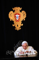 Pope Benedict XVI signs the honour book at Belem Palace in Lisbon, 11 May 2010. Pope Benedict XVI is on a four days official visit to Portugal to attend the annual celebrations of the Our Lady 13 May 1917 apparition to the three little sheferds and the 10th year of their beatification.