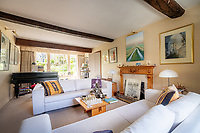 BNPS.co.uk (01202) 558833.<br /> Pic: CarterJonas/BNPS<br /> <br /> Pictured: Living room. <br /> <br /> The former family home of Lord of the Flies author William Golding has gone on sale for £1m.<br /> <br /> The Grade II Listed cottage on a green in Marlborough is said to have inspired some of the Nobel Prize winning writer's work.<br /> <br /> His parents Alec, a teacher, and Mildred, a suffragette, bought the house and moved there in 1905, when Mr Golding obtained a job at the town's grammar school.<br /> <br /> Sir William was born in 1911 and he and his brother lived in the property and its location influenced his writing. He wrote of the property: 'Our house was on the green, that close like square, tilted south'.