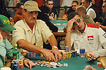 Gene Strickland rakes in a big pot as Gabriel Alerie, at right, agonizes over his loss.