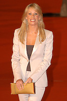 """ALESSIA MARCUZZI.Attends the film premiere of """"Fur: An Imaginary Portrait of Diane Arbus""""  during the first day of the Rome Film Festival, Roma, Italy,.October 13th 2006..half length gold hoop earrings cream suit jacket clutch bag red carpet.Ref: CAV.www.capitalpictures.com.sales@capitalpictures.com.©Luca Cavallari/Capital Pictures."""