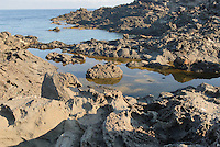 - island of Pantelleria,  the coast near Fram Point, formed by the ancient lava casting of Gelkhamar....- isola di Pantelleria, la costa nei pressi punta Fram, formata dall' antica colata di lava di Gelkhamar