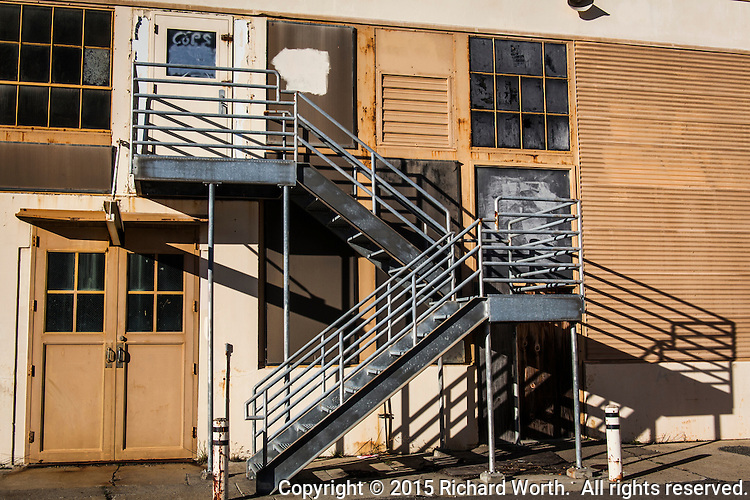 A metal staircase creates lines and angles on a vacant building at the former Naval Air Station Alameda near the USS Hornet Museum.
