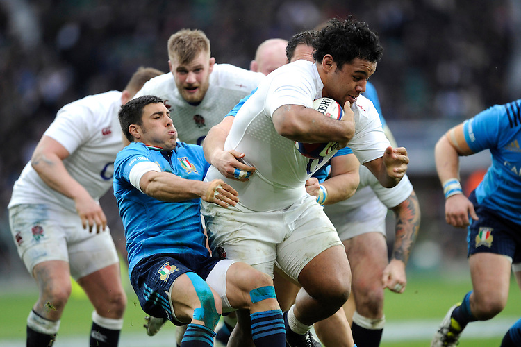 Billy Vunipola of England makes ground despite the attentions of Edoardo Gori of Italy during the RBS 6 Nations match between England and Italy at Twickenham Stadium on Saturday 14th February 2015 (Photo by Rob Munro)