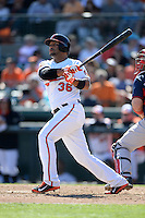 Baltimore Orioles infielder Alex Gonzalez (36) hits a home run during a spring training game against the Boston Red Sox on March 8, 2014 at Ed Smith Stadium in Sarasota, Florida.  Baltimore defeated Boston 7-3.  (Mike Janes/Four Seam Images)